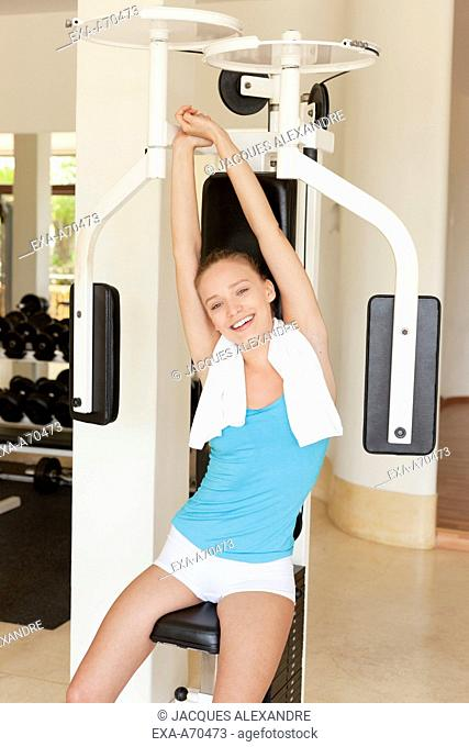 Woman exercising in fitness club