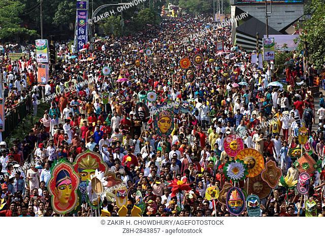 DHAKA, BANGLADESH - APRIL 14 : Bangladeshis attend a rally in celebration of the Bengali New Year or Pohela Boishakh in Dhaka, Bangladesh on April 14, 2017