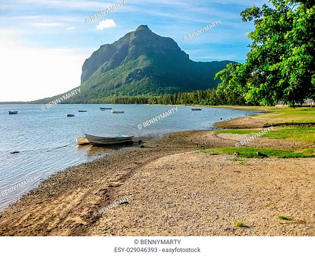 The beautiful beach of Le Morne Brabant with its boats, famous for kite surfing. The peninsula is dominated by a mountain of basalt rock and is Unesco Heritage