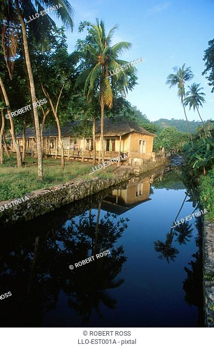 View of Chalet Rooms with Canal in Foreground  Sao Tome, Sao Tome Principe, West Africa