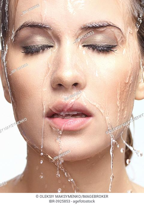 Water running over woman's face