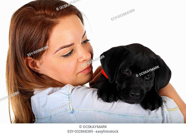 Picture of a woman with her black labrador puppy