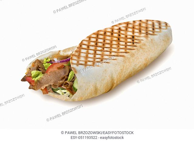 Greek gyros pita isolated on white background. For fast food restaurant design or fast food menu. Pita stuffed with meat and vegetables on white background