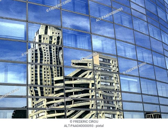 Building reflected in window panes