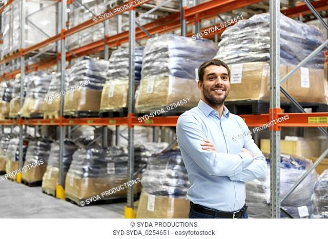 happy businessman at warehouse
