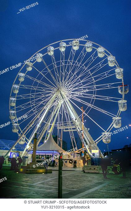 HDR image of an Illuminated christmas ferris wheel in Jubilee Square Leicester, UK