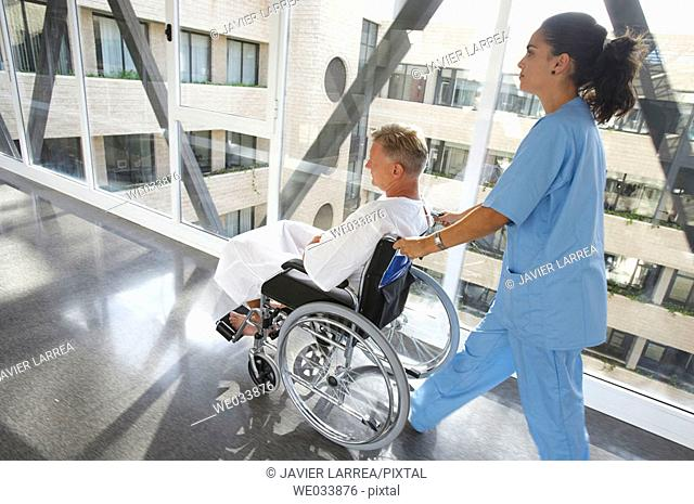 Nurse pushing patient in wheelchair