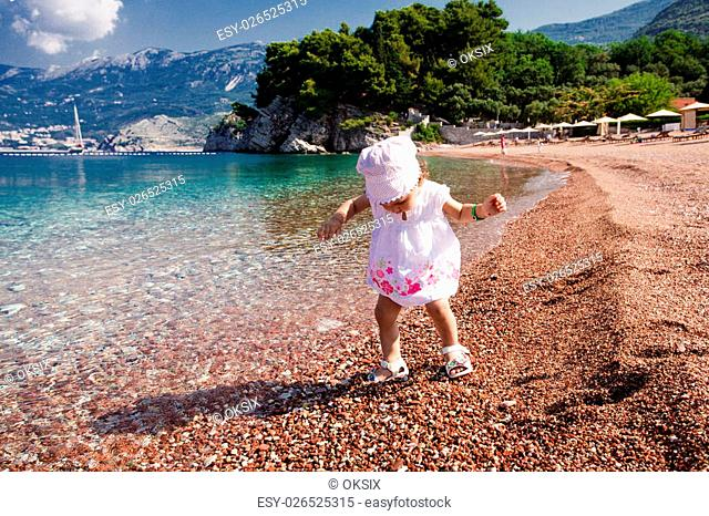 First steps to the sea. Adriatic seashore St. Stefan, Montenegro