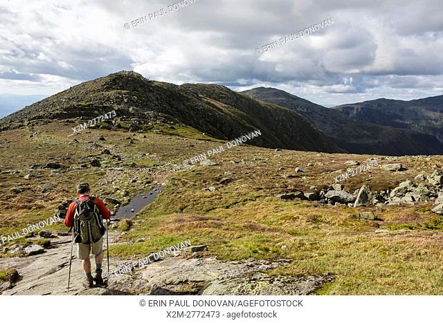 A hiker on the Appalachian Trail descending Mount Washington. Located in the White Mountains, New Hampshire USA