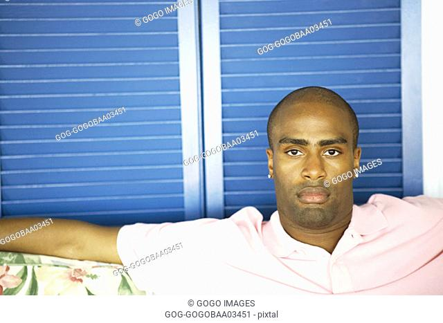 Young African man relaxing on a couch