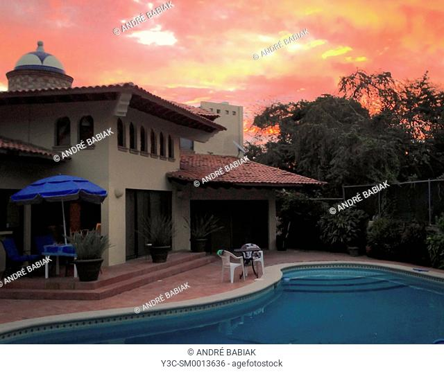 Residential home with swimming pool at sunset, Puerto Vallarta, Mexico