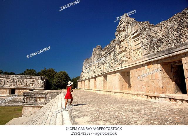 Tourist woman near the Quadrangle Of The Nuns in Uxmal Ruins, Uxmal, Yucatan Province, Mexico, Central America