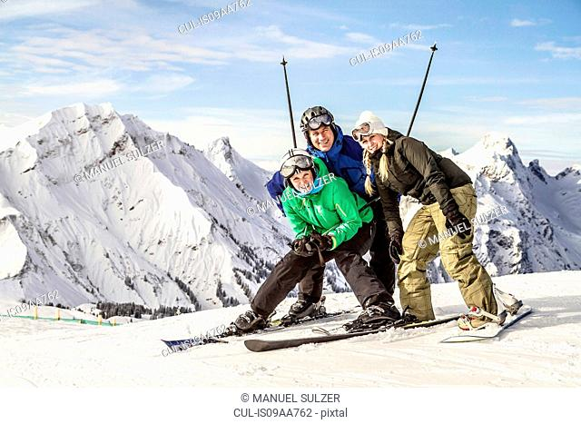 Group portrait of skier friends, Warth, Vorarlberg, Austria