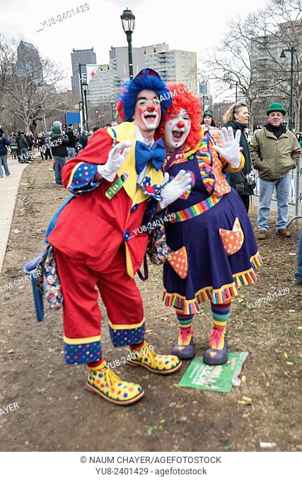 Funny clowns amuse children on the streets, St. Patrick's Day Parade, Philadelphia, USA