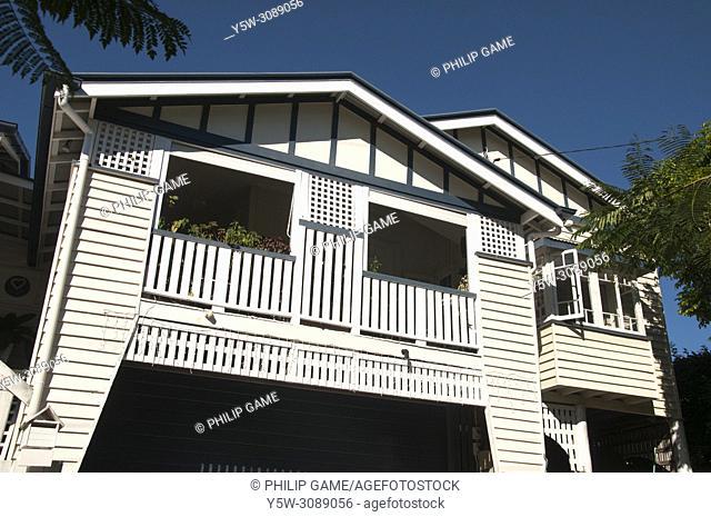 Queenslander-style timber homes ca. 1913, typically featuring Art Nouveau decorative motifs, Brisbane, Australia