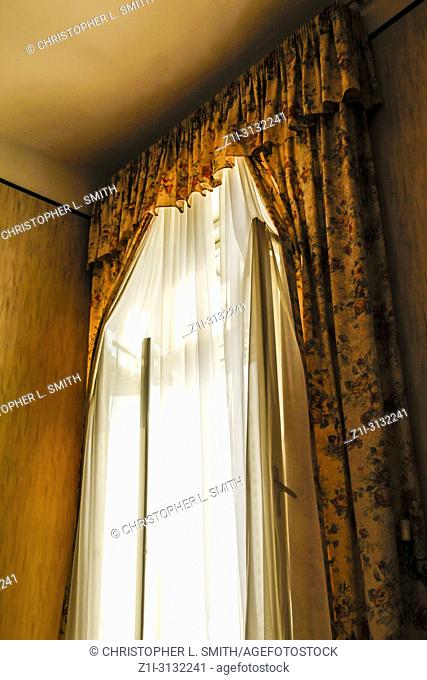 Net curtains and heavy drapes in the hotel rooms at the Imperial Hotel in Opajia, Croatia