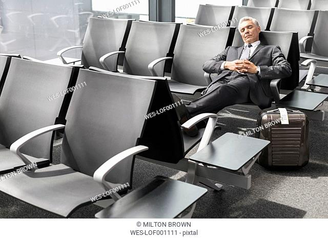 Businessman sleeping at the airport