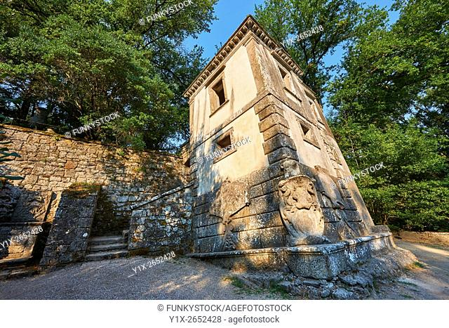 Casa Pendente, a leaning house commissioned by Piaer Francesco Orsini c. 1513-84, in The Renaissance Mannerist statues of the Park of Monsters or The Sacred...