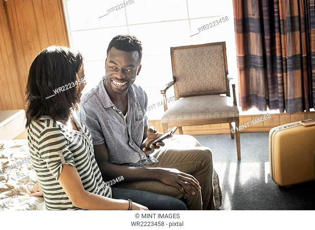 A young couple in a motel room