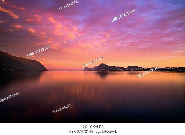 Colorful summer sunrise at Langevag with the view toward Alesund and the islands Heisa and Godoya on background, Langevag, Vestlandet, More og Romsdal county