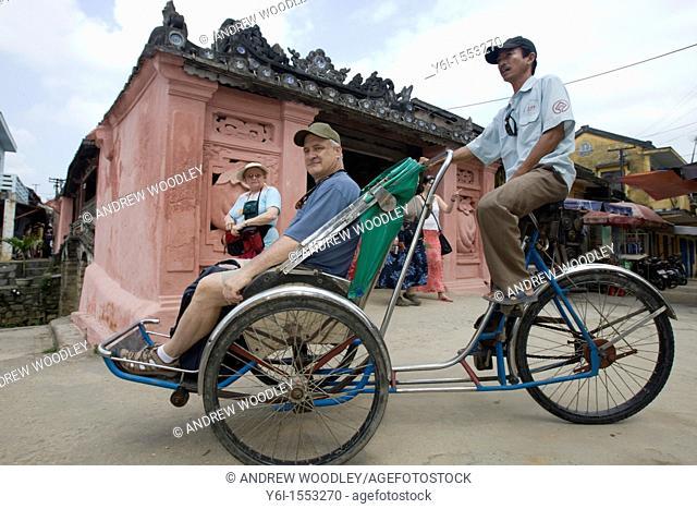 Tourist rickshaw at landmark Japanese Covered Bridge Hoi An Vietnam