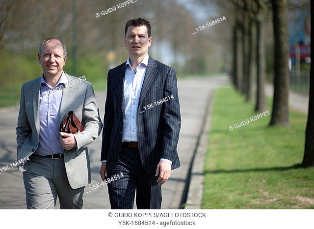 Veenendaal, Netherlands. Strategic manager and his assistant making a walk during lunch hour