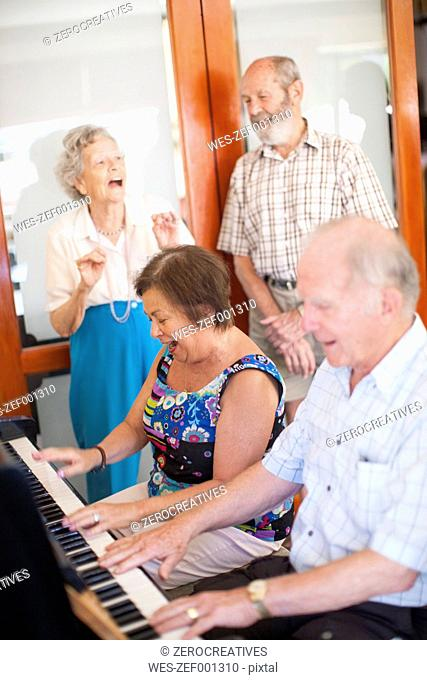 Senior people making music in a retirement village