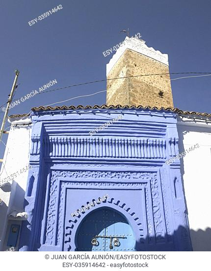 Traditional powder blue painted house facade and door in the historical Medina of Chefchaouen, Morocco