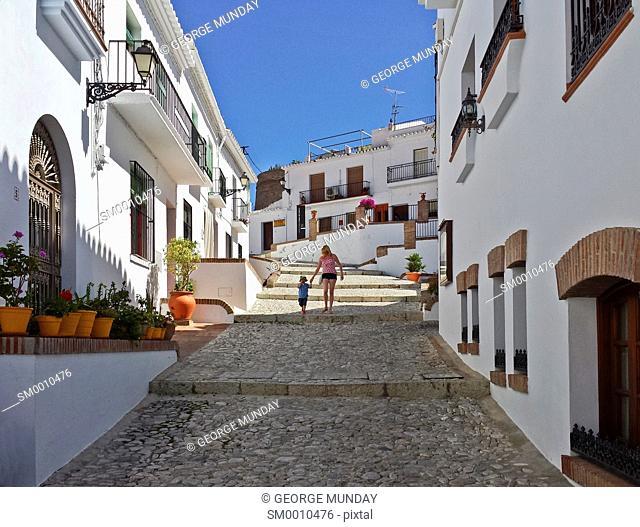 Mother and son walking of the streets in Frigiliana, Near Nerja, Malaga, Spain