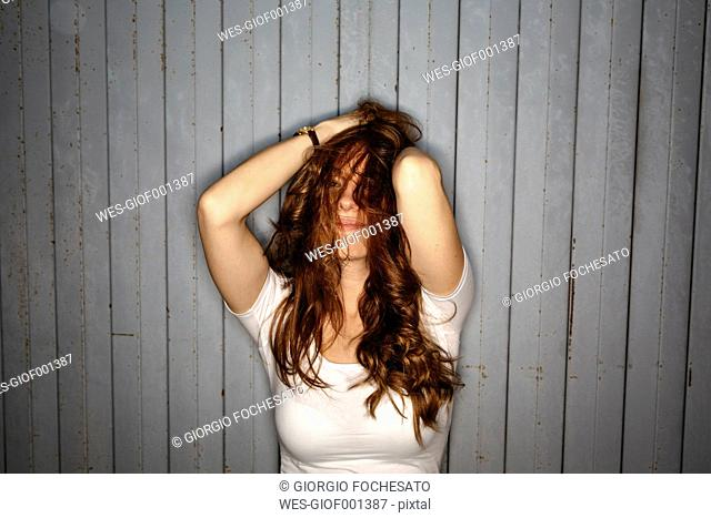 Redheaded young woman with dishevelled hair