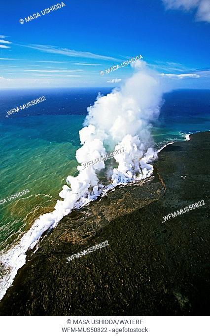 Aerial view of coast line at Kilauea, hot molten lava enters cold ocean, Volcanoes National Park, Kilauea, Big Island, Hawaii, USA