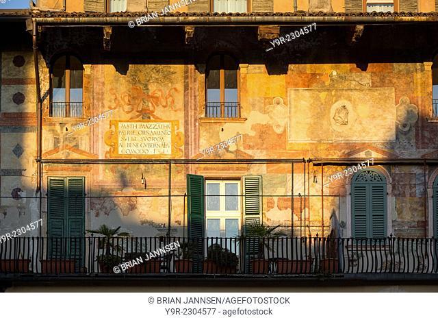 Setting sunlight on the historic buildings surrounding Piazza Erbe, Verona, Veneto, Italy