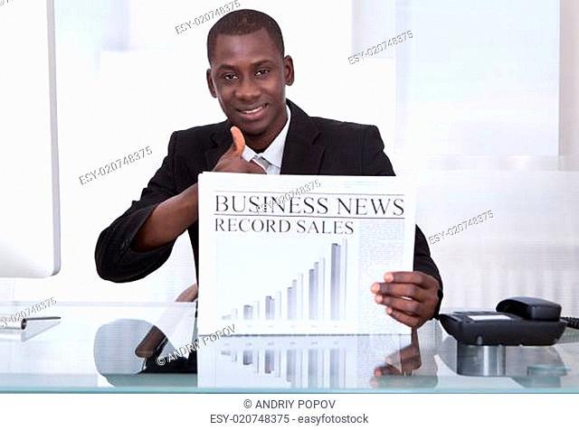 Businessman Showing Newspaper