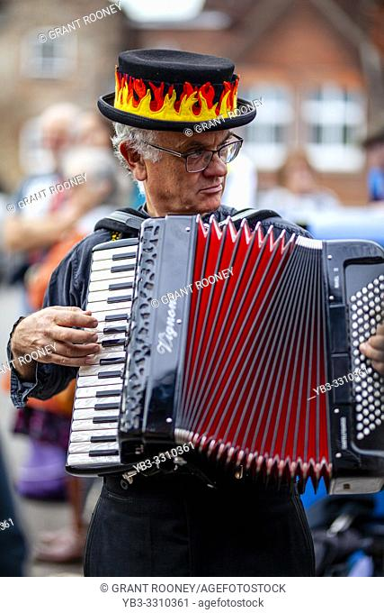 A Morris Man Plays The Accordion As Eighteen Morris Dancing Sides From Around The South East of England Perform At The Annual Lewes Folk Festivalâ