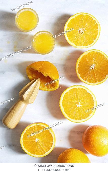 Sliced oranges with juicer