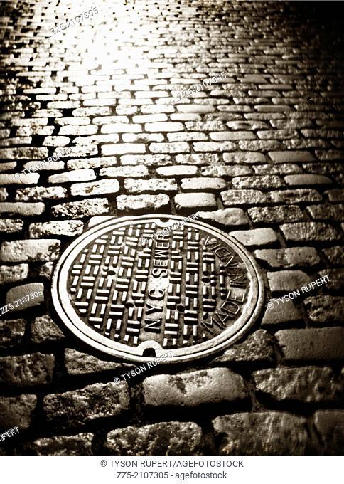 manhole cover cobblestone street