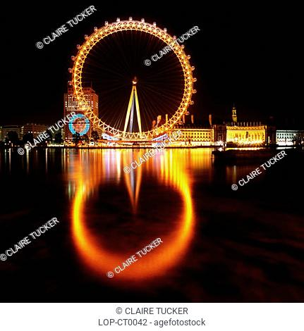 England, London, South Bank, The British Airways London Eye at night. Opened in 1999, it stands at 135m tall making it the largest observation wheel in the...