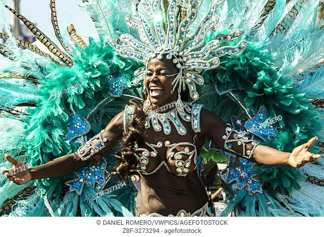 Woman dressed in carnival costume. . The battle of flowers is an event that takes place on Saturday of Carnival. It is a parade of floats, comparsas, cumbiambas