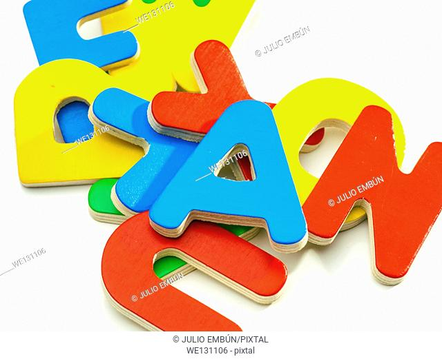 group of colored wooden letters jumbled