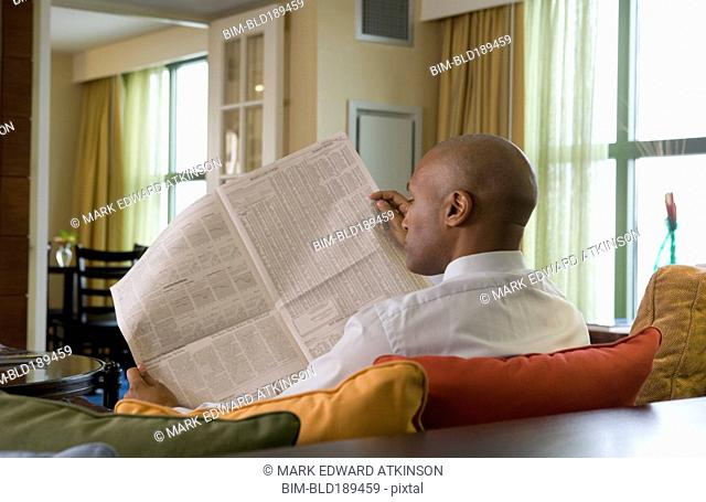 African businessman reading newspaper