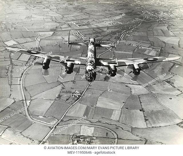 Royal Air Force RAF Avro 683 Lancaster Flying Enroute over Fields and Trees