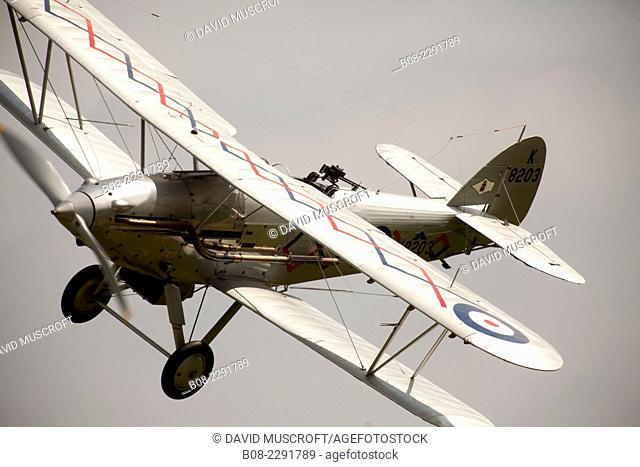 1930's RAF Hawker Demon fighter biplane aircraft at a Shuttleworth Collection air display at Old Warden airfield, Bedfordshire ,UK