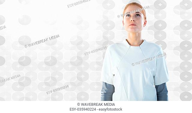Woman looking up with bright pattern background