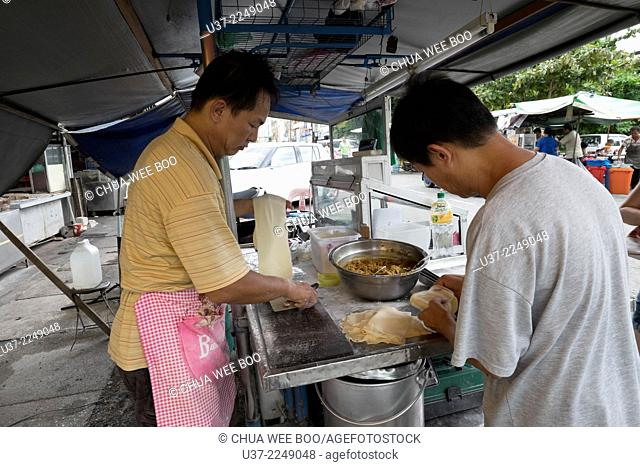 Vendor making curry puffs, Alor Setar, Kedah