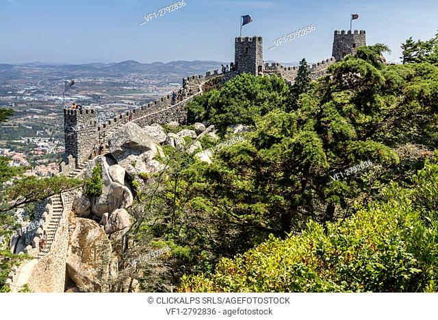 The ancient Castelo dos Mouros with its stone towers surrounded by woods Sintra municipality Lisbon district Portugal Europe