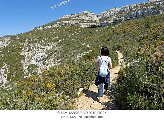 Woman hiking in the Sainte-Baume Mountains, Provence, France, Europe