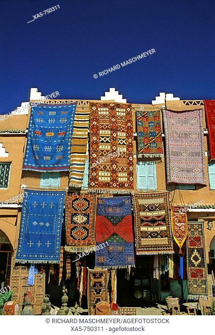 Morocco, Middle Atlas village, carpets on storefront display