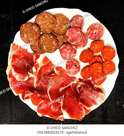 Blood sausage, salami, sausage and ham from Iberian pigs in Carniceria Ana, Prado del Rey, Sierra de Grazalema, Spain