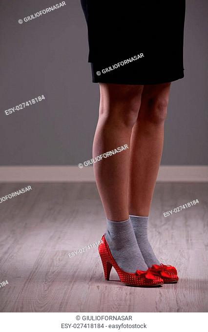 woman legs with socks and red high heel shoes