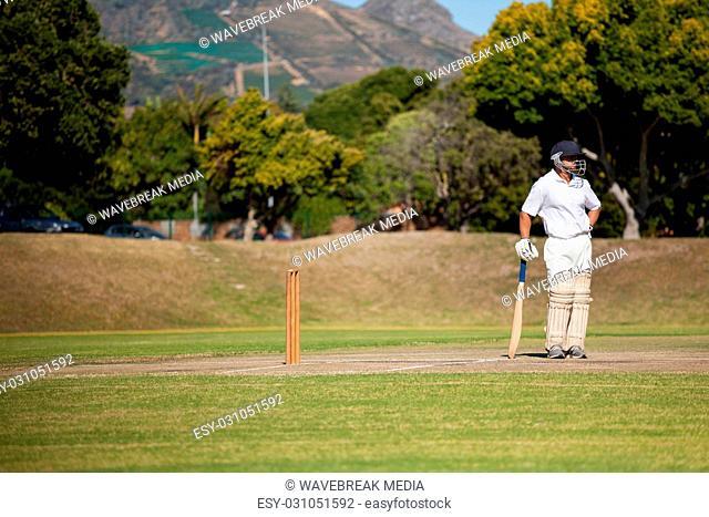 Batsman standing on field during match